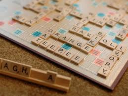 Scrabble tile orange