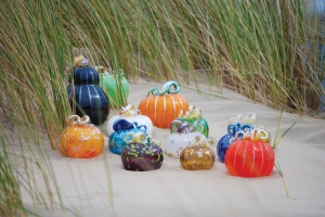 Pumpkins on Beach by Coastal Magazine